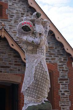 Lace yarnbomb statue