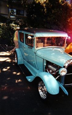 blue vintage car...rosanne maccormick-keen, via | http://best-cars-and-such-collections.blogspot.com