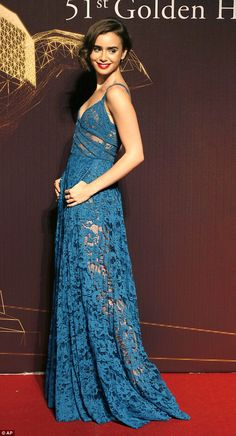 Lily Collins oozed Hollywood glamour as she posed on the red carpet for the 51st Golden Horse Awards in Taipei.
