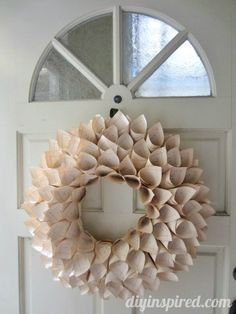 Make a Recycled Book Page Wreath with this Step by Step Photo Tutorial.