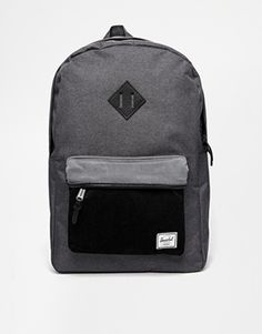 Herschel Heritage Backpack http://www.asos.com/herschel/herschel-heritage-backpack/prod/pgeproduct.aspx?iid=4788749&clr=Black&SearchQuery=dakine+backpack&pgesize=36&pge=1&totalstyles=543&gridsize=4&gridrow=8&gridcolumn=4