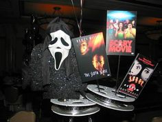 @Amanda Churak @Tara Mitchell How cute is this centerpiece idea!!!!!  I want to do this!!    Google Image Result for http://www.mazelmoments.com/blog/wp-content/uploads/2012/06/Hollywood-Scary-Movie-Centerpieces.jpg