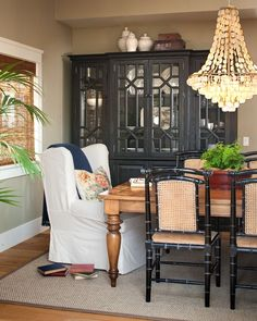 The farmhouse style dining table pairs with a white slipcovered captains chair and black bamboo style side chairs with cane seat and back. Description from decorpad.com. I searched for this on bing.com/images