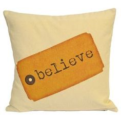 Cream cotton-linen blend pillow showcasing a printed orange tag with believe in block lettering.   Product: PillowConstruction Material: Cotton and linenColor: CreamFeatures: Insert included Knife edgeDimensions: 20 x 20
