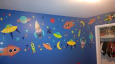 Blast Off! Space theme kids room decor in a blue bedroom
