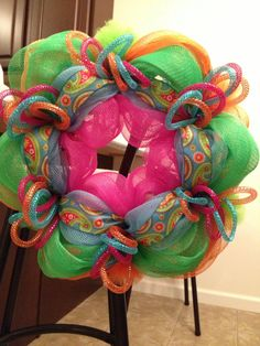 A Summer Deco Mesh Wreath that uses Deco Flex Tubing in a whole new way!