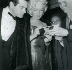 Marilyn and Milton Greene arriving at the Friars Club Testimonial Dinner, 11 March, 1955.