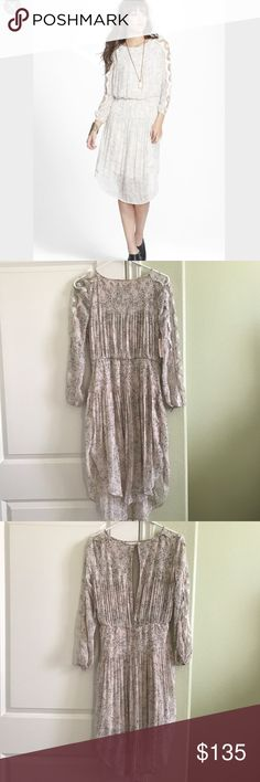 FREE PEOPLE  Charlotte  Dress in Alabaster NWT Round neck Long sleeves with sheer lace panels Elasticized waist Button cuffs Gathered skirt Open back with hook closure Lined  MATERIAL  Shell: 100% Polyester Lining: 100% Rayon Lace: 70% Rayon, 30% Nylon Free People Dresses Midi
