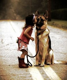 Girl and German Shepherd kiss... Awww I love this. Every child should be able to grow up with a dog.