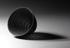 Black stained porcelain, handperforated by Linda Prüfer.