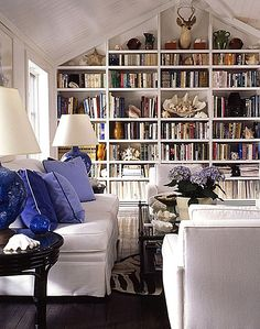touch of periwinkle blue, bookshelves, comfortable seating, glass coffee table, hydrangeas. Library Bookshelves, Blue Bookshelves, Bookcases, Bookshelf Wall, Bookshelf Styling, Home Libraries, Living Spaces, Living Room, Home And Deco