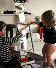 DIY marble run. Thankfully I saved all those silly toilet paper rolls. I knew there'd be a use for them somewhere!