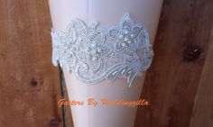 Sexy silver #wedding #garter, on SALE!  Silver and white lace wedding garter set, I hand beaded it with pearls and clear sequins to add sparkle  to make it one of a kind.  The lace #bridal garter  is accented with... #bride #weddings #silvergarter #gartersale #bridalgarter #weddinggarter