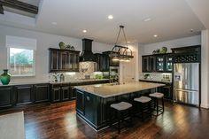 Gehan Homes Kitchen - Spacious Kitchen, Storage - Light Granite Countetops, Huge Island, Dark Cabinets, Stainless Steel Appliances, Wine Rack - Houston, Texas | Westover Park Classic - Princeton #Gehanhomes
