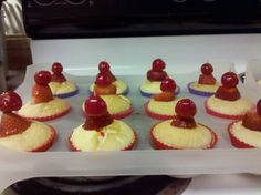 Angel food cupcakes with fruit on top (with a tooth pick)