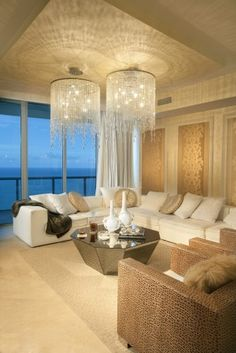 LOVE this living room (the view is Miami....close to home! :) Mainly the lighting and the way it dances on the ceiling, but also loving the couch and the wall decor blending with the room.