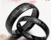 Handmade Anywords Black Matching 18K Gold Wedding Engagement Titanium Rings Set. $149.00, via Etsy.