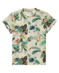 Mimic the tropical holiday feel with this feminine shirt.