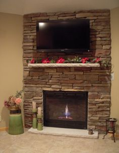 fireplace rock   Stone fireplace with mounted TV