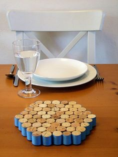 Wine cork trivet | DIY Glory @Mary Dyk  here is one...I like how they wrapped the corks in ribbon...Red ribbon mom?