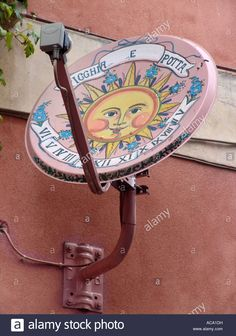 Download this stock image: Satellite dish painted with a sundial, Taormina, Sicily, Italy - ACA1DH from Alamy's library of millions of high resolution stock photos, illustrations and vectors.