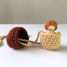 Acorn crochet necklace with baby inside
