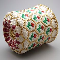 This rose pattern collectible beaded basket is made of hundreds of tiny Japanese delica seed beads woven together with needle and thread. Designing and making these small baskets is a lengthy process but I enjoy it and find it meditative. Approximate dimensions: 1 3/4 inches high 1 3/4 in diameter 1 3/4 inches wide Free USA shipping and sent in a gift box. Thanks for looking at my Etsy shop.