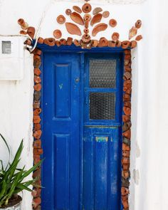 #ihavethisthingwithdoors clearly Another pretty door with ceramic details in Sifnos Places To Travel, Boston, Travel Tips, Greece, Ceramics, Doors, Anna, Pretty, Instagram