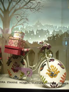 Whimsical window display, an example to show applicants for their participation in designing windows for EMC. This would be for an Artswave program and neighborhood schools to utilize. Escaparate en Paris window display. #retail #merchandising #windowdisplay