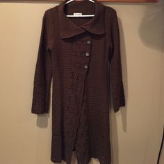 Long Brown Knit Sweater Long knit sweater. Cute detailing on sleeves, down the front, and bottom edge. Tag says small, but will also fit medium. Sweaters Cardigans