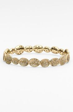 Free shipping and returns on Melinda Maria 'Margaret' Pod Bangle at Nordstrom.com. Light-capturing crystals embed an endless trial of concave, textured stations for a showstopping, handcrafted bangle.