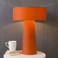 Add a dose of color / energetic vibe to your home with this modern, orange Bradley table lamp by Surya! (BRA-865)