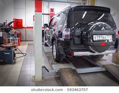 MOSCOW, MAR,02, 2017: Car automobile at wheel alignment maintenance works repair at automotive service center workshop. Technical maintenance wheel alignment correction fixation MOT. Car maintenance Wheel Alignment, Moscow, Automobile, Photo Editing, Workshop, Stock Photos, Pearls, Car, Editing Photos