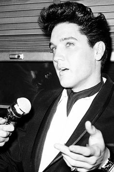 Elvis Presley being interviewed on the train to California, April 20, 1960.