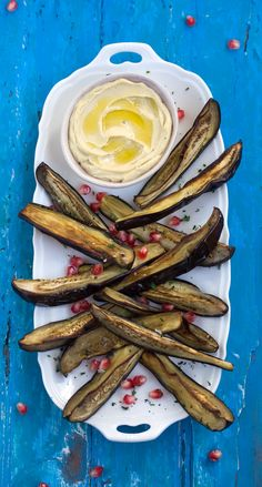 Oven roasted aubergine wedges with hummus