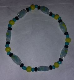 Mixed glass bead bracelet - stretchy - black, turquoise, yellow, aqua by BritkneesBootique on Etsy