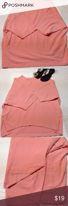 High low 3/4 sleeve rose colored top Super soft rose colored top. The back is a little longer than the front. As shown in picture side slits. Sleeves are about 3/4. Rose colored. Never worn still with tags I purchased from another posher and it does not fit me Tops