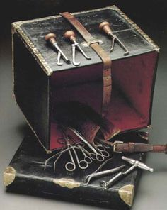 """This photograph is of a travelling surgeon's instrument case. Shown are an extraction forceps, an English tooth-key, and several miscellaneous """"tools of the trade."""