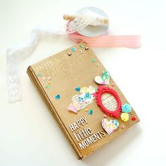 Altered book-has lots of pages that are decorated. Uses lots of tags and die cuts