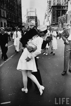 This iconic photo depicts the jubilance and relief expressed throughout America when armistice was declared in World War Two. Contrary to popular opinion, the two in the picture were not lovers; the soldier was jubilantly planting kisses on women in.