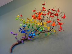 Teach a whole class to make origami cranes for a teacher gift. There are tons of origami instruction videos online. Alternatively, you can also use origami flowers or string the cranes up in a mobile. I love the ROYGBIV pattern here. Origami Diy, Origami Paper, Origami Cranes, Paper Cranes, Origami Birds, Origami Tree, Origami Butterfly, Butterfly Tree, Bird Tree