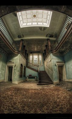This creepy old manor house could be the very place where Perry's darkest family secret began with the fate of his wife, Rowena: abandoned stairs ~ Harlequin Manor - Derelict Places Abandoned Buildings, Abandoned Property, Abandoned Castles, Old Buildings, Derelict Places, Abandoned Places, Old Mansions, Abandoned Mansions, Beautiful Buildings