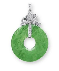 A JADEITE AND DIAMOND PENDANT  Set with a jadeite hoop of bright emerald green colour and very good translucency, to the brilliant and baguette-cut diamond foliate surmount, mounted in platinum, hoop diameter approximately 29.8 mm, thickness approximately 2.3 mm, 4.6 cm long