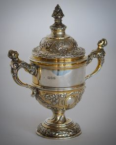 LOT 65: A good quality silver gilt trophy cup the body heavily decorated with scrolls and leaves. London. By WE. Approx. 727 grams. Est. 350 - 400. Hammer price: 400. SOLD in our SPRING AUCTION on Thursday 9th March inclusive of #Silver #Jewellery #Watches #Collectables #Pictures #China & #Antique #Furniture. #March9 #whittonsauctions #auction #Honiton #pin