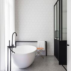This ensuite certainly has its priorities straight ⚫️⚪️ Minimalist and monochrome for maximum tub-time peace 🛁 Beautiful bathroom by @arentpykestudio 📷 by @tfadtomferguson styling by @emmaelizabethdesigns for @bellemagazineau #bathroom #bathroomgoals #bathroomdesign #bathroominspo #tubtime #interiordesign  #interiorinspo #darlinghurst