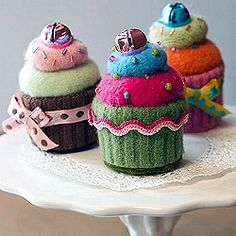 Have any old sweaters you would like to recycle?  Make these cute cupcake pincushions!