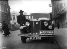 British actor Charles Laughton (1899-1962) getting into his car outside 'The Old Vic' theatre in London.