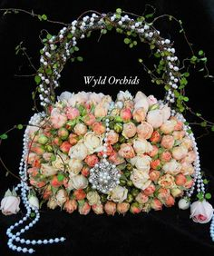 Floral Handbag Centerpiece www.tablescapesbydesign.com https://www.facebook.com/pages/Tablescapes-By-Design/129811416695