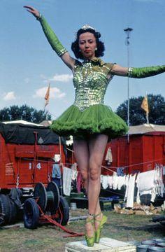 Wire Walker in Wardrobe ::Lola Dobrich, Swiss tight wire walker standing on a prop pedestal on toes in green wardrobe. July 28, 1951. Minneapolis,MN