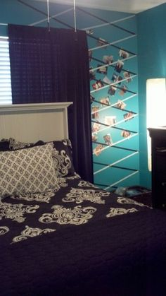 Teal/Black Teenagers Room, We were looking to update my 16 year old daughters room and make her a space of her own.  A little more sophisticated but still playful!  , Ribbons secured with cute thumbtacks make a picture wall!, Girls Rooms Design
